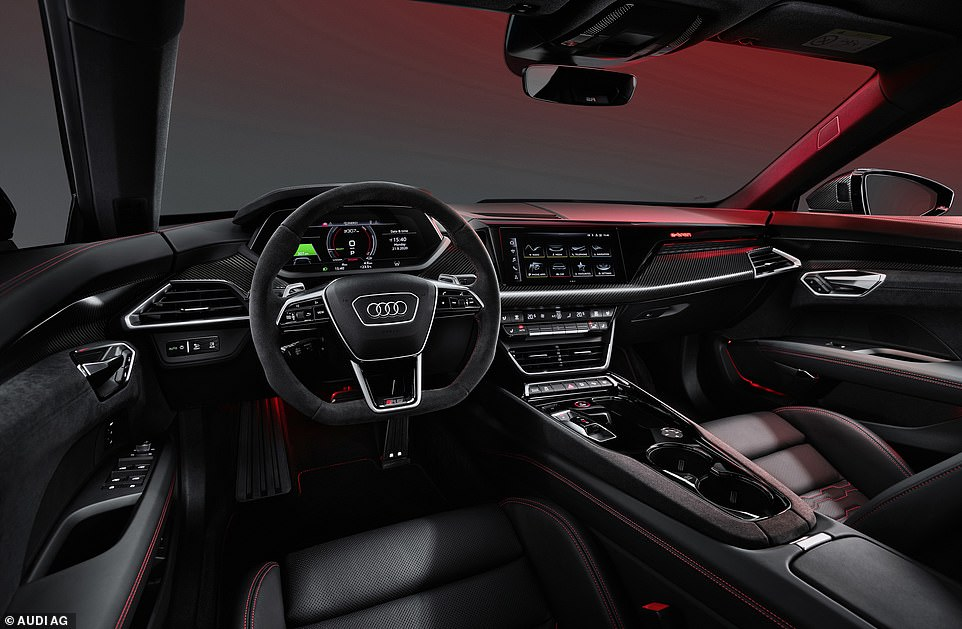 The cockpit is designed to face towards and surround the driver who is separated from the front passenger by a wide centre console housing the gear selector switch