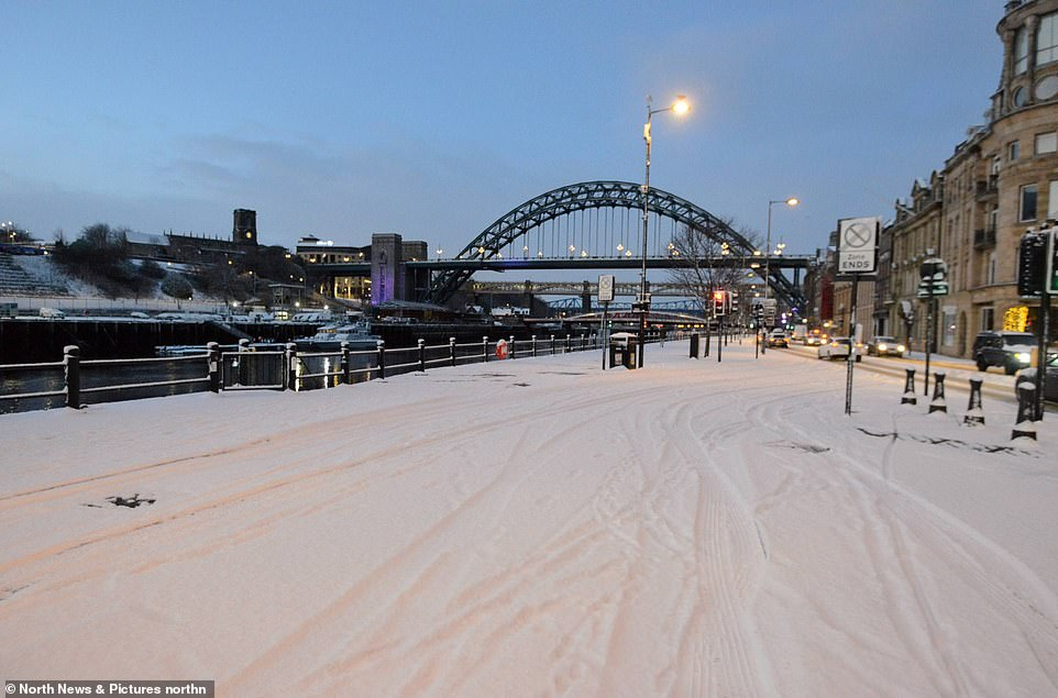 A snow-covered Newcastle Quayside stands deserted this morning after overnight snow across the North East