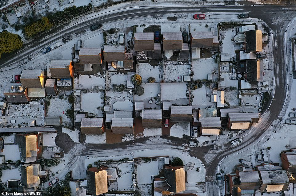 The wintry weather brought by Storm Darcy has carpeted large areas of central and eastern England and Scotland with snow. Pictured, Blidworth Village, Nottinghamshire