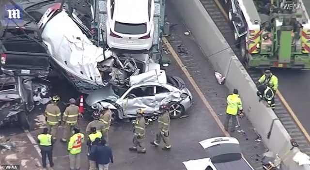 First responders described the scene as a 'mass casualty incident' with crushed cars stacked on top of one another and helpless drivers stuck inside