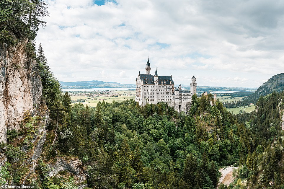 """This amazing image shows the famous Schloss Neuschwanstein - a 19th-century castle built by Ludwig II near the village of Schwangau. It is said to be the main inspiration for the design of Disney's Cinderella's Castle. According to the castle's website, 'every year 1.4million people visit """"the castle of the fairy-tale king""""'"""