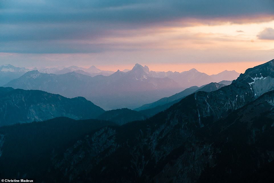This mesmerising shot of a purple-hued sunset shows the view from a ridge in the Ammergau Alps, just outside of Garmisch-Partenkirchen, towards Reutte, a market town across the border in Austria