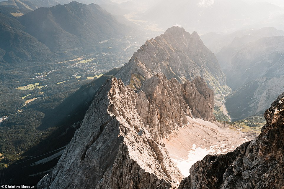 An amazing shot taken from the summit of Zugspitze looking down on the town of Garmisch-Partenkirchen. In 2020, Christine and Scott reached the peak of more than 50 different mountains in the Alps, the majority of them in Bavaria