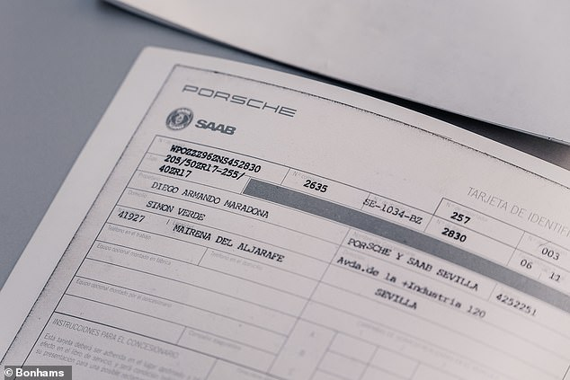 The car comes with a number of items of paperwork showing the famous football to be the first owner
