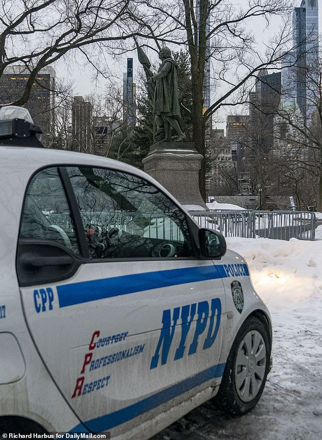 In Central Park, at least two cop cars as well as a metal barricades were seen erected around the statue on Friday