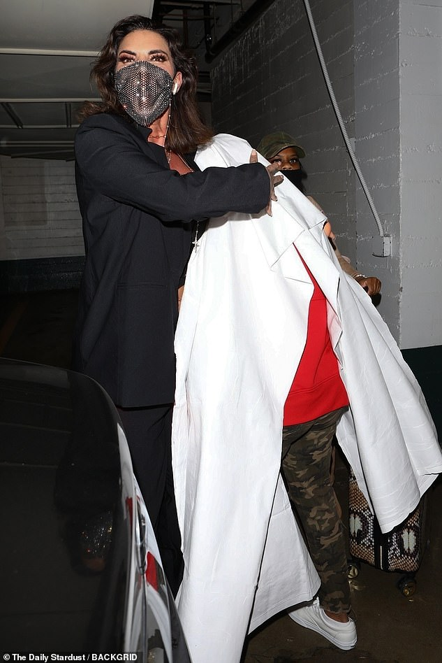 Freedom! Images taken on Wednesday night showed Tessica leaving Dr. Obeng's office under a white sheet