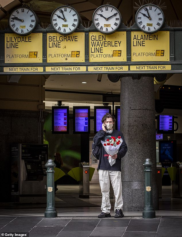 A Melbourne man outside Flinders Street Station on Sunday during the five-day lockdown