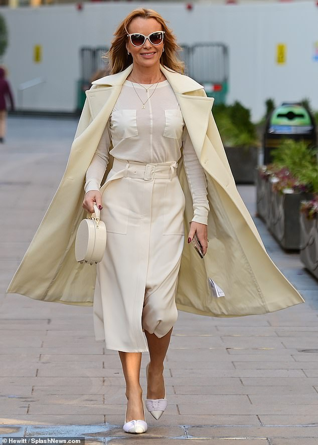 Amanda Holden, 49, (pictured leaving Heart Radio on Wednesday) has said she is 'devastated she had to break the rules' after being reported to police for making a 215-mile trip