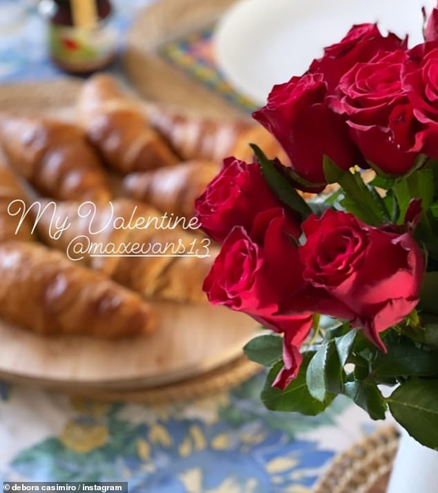 Special lady:Debora was presented with croissants and roses for a romantic breakfast as the couple celebrated Valentine's Day on Sunday