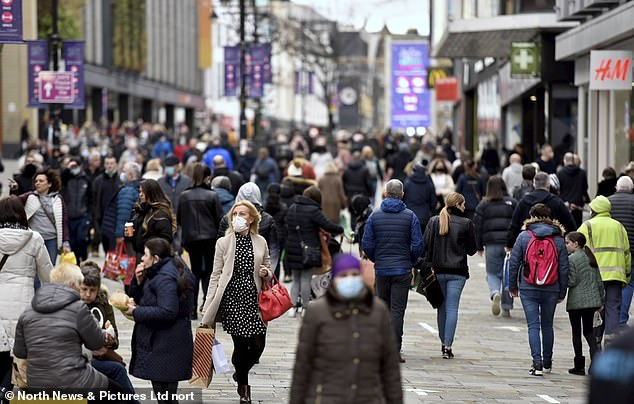Plans to ease lockdown were boosted yesterday by figures showing the dramatic impact vaccines are already having (packed high street pictured during December last year before the latest lockdown was imposed)