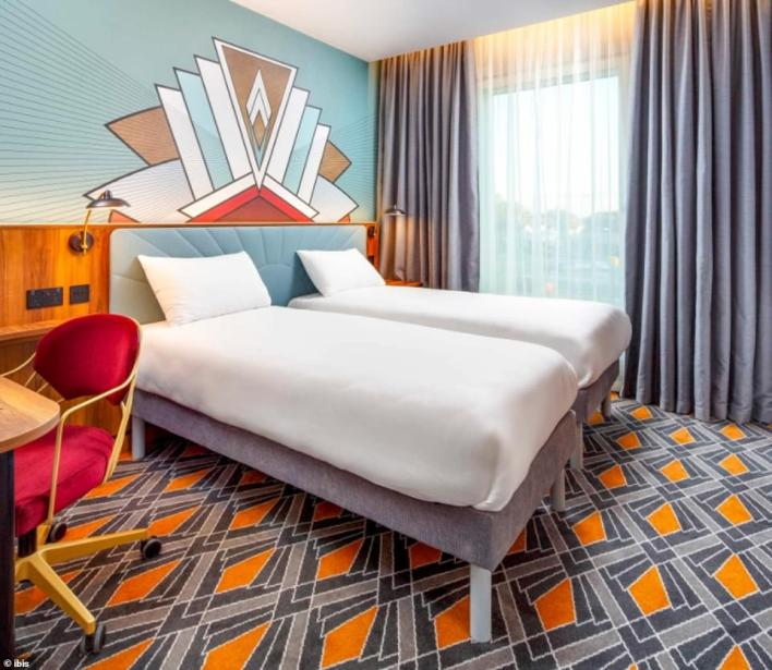 A three-star Ibis will be among the hotels welcoming Heathrow arrivals as part of the government's travel quarantine programme, MailOnline can reveal. Pictured is one of the twin bedrooms