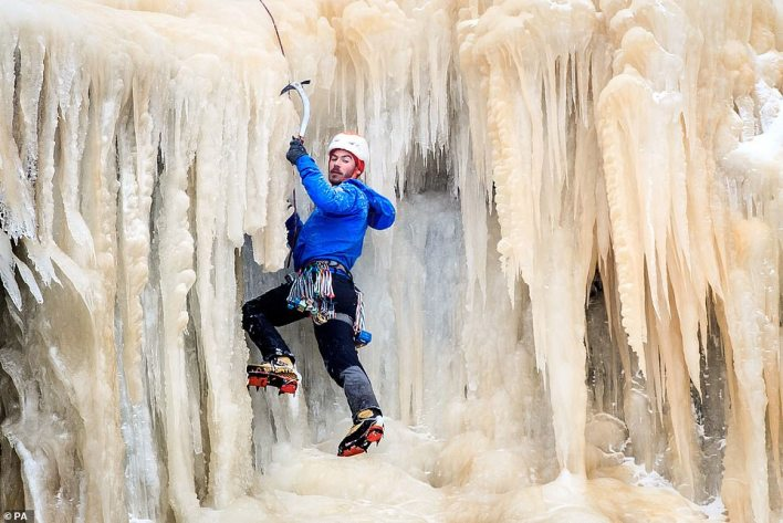 In Derbyshire's High Peak area, the impressive Kinder Downfall also froze, turning the 98ft waterfall into a slippery climbing wall
