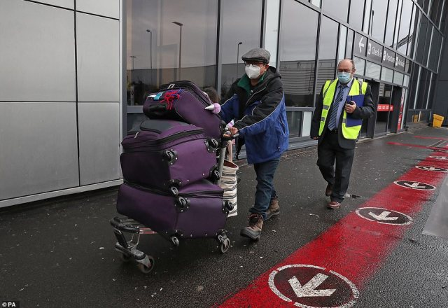 Chun Wong leaves Edinburgh Airport after entering the country on the first day that travellers flying directly into Scotland on international flights have to self-isolate for 10 days in a quarantine hotel room