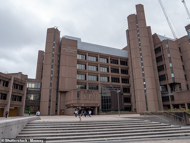 Carpenter, 33, appeared at Liverpool Crown Court (pictured) alongside Adam Achramowicz, also 33, who drove Carpenter and another male from Milton Keynes to Liverpool