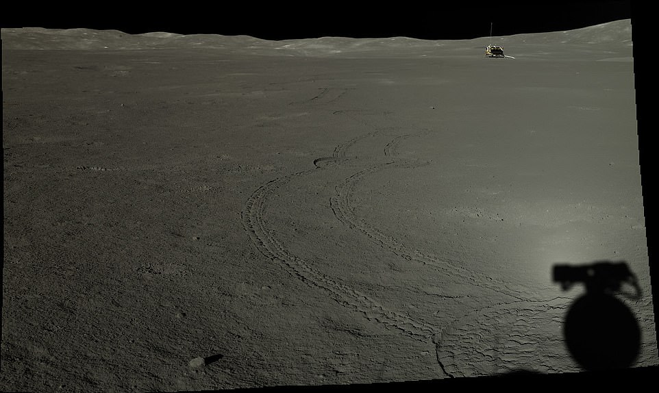 China's space agency released a gallery of images snapped by the rover in January 2020 to mark the one-year anniversary since the craft first arrived on the moon. Pictured is the rover's tracks on the lunar surface and in the distance sits the lander