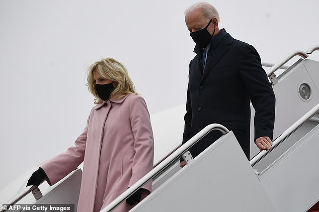 President Joe Biden changed into a longer overcoat on the plane while Jill Biden wore a soft pink coat for the trip back to the White House