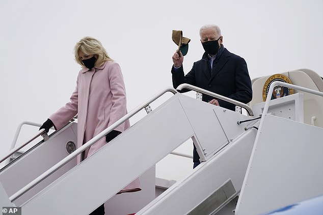 President Biden doffs his cap upon arrival at Joint Base Andrews - the hat bore the 'Camp David' logo and was a gift from his grandkids