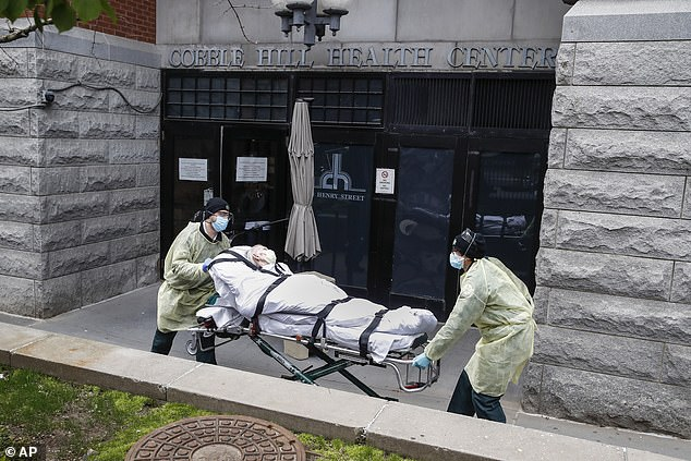 Cuomo slammed 'conspiracy theories' around the scandal as he stated in a press conference that his March order on nursing homes was the subject of 'distortion'. Pictured,a patient is wheeled out of the Cobble Hill Health Center by emergency medical workers in April 2020
