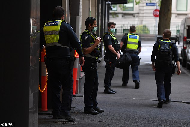The hotel is a 'hot hotel' meaning it accommodates returned travellers who have tested positive for Covid-19 or are presenting with symptoms. Pictured: Police outside the hotel