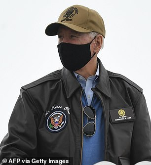 President Joe Biden decked out in presidential gear - Air Force One aviator jacket with his name on it and a Camp David cap