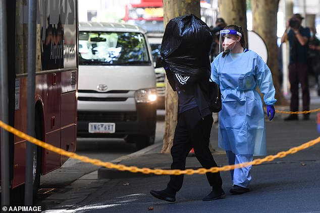 A returned Australian evacuated from a Melbourne quarantine hotel emerged wearing a large rubbish bag over their head on Tuesday morning