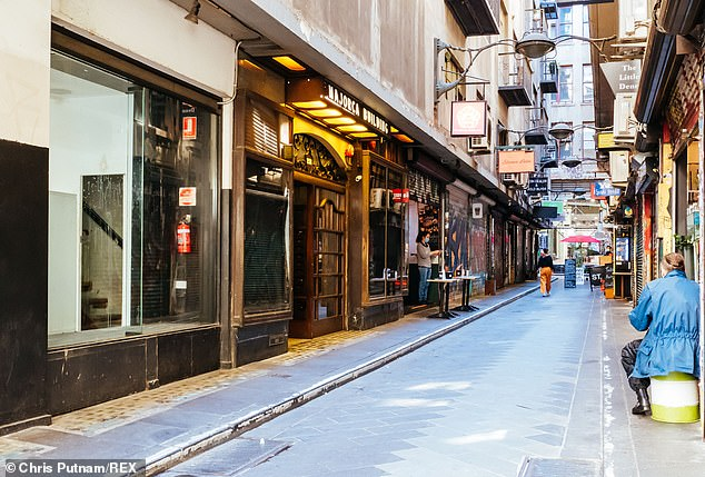 Pictured, Degraves Street central Melbourne on Tuesday morning as Victoria endured its fourth day of the current lockdown