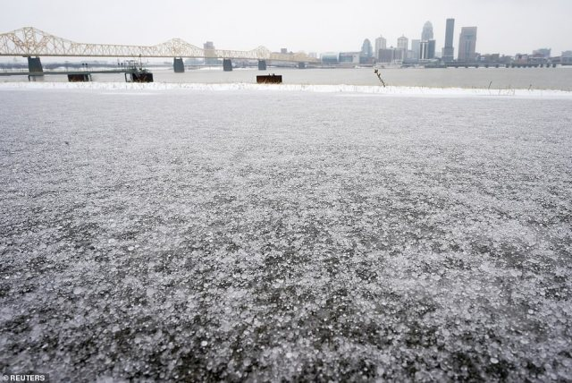 KENTUCKY: Louisville is seen in the distance as ice coats a sidewalk along the Ohio River
