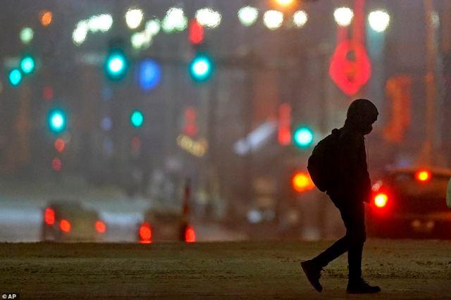 MISSOURI:A man crosses a street as temperatures drop below 0 degrees Fahrenheit Monday, in downtown Kansas City