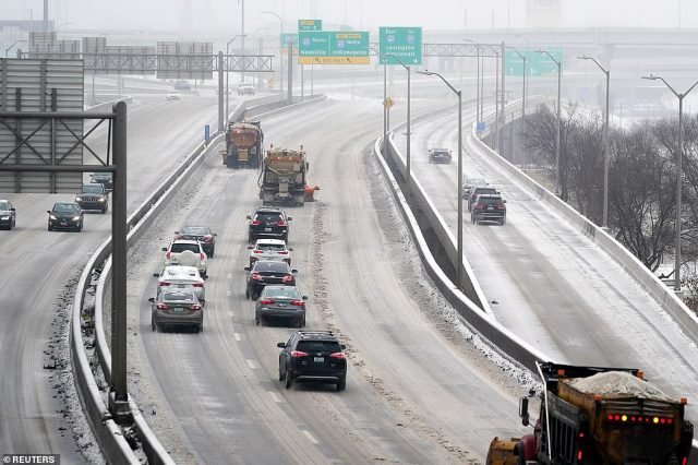 KENTUCKY:Plows clear snow and ice from Interstate 64 during a winter storm in Louisville, amid the dangerous storm