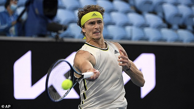 Zverev pictured in action against Serbia's Dusan Lajovic at the Australian Open on Sunday. He is preparing to face Novak Djokovic in a quarter-final showdown at the Australian Open on Tuesday night