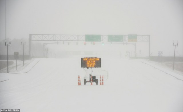 MISSISSIPPI:A sign warns motorists after a sudden heavy bout of snow and frozen rain on MS Highway 463 in Madison, north of Jackson