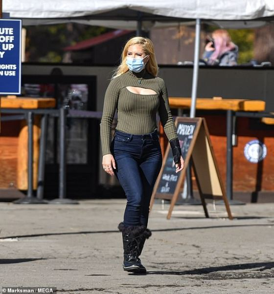 Looks good: Heidi Montag cut out a modern figure in a cut-out khaki bar as she continued filming scenes for the reality show The Hills: New Beginsnings in Lake Tahoe, California last week