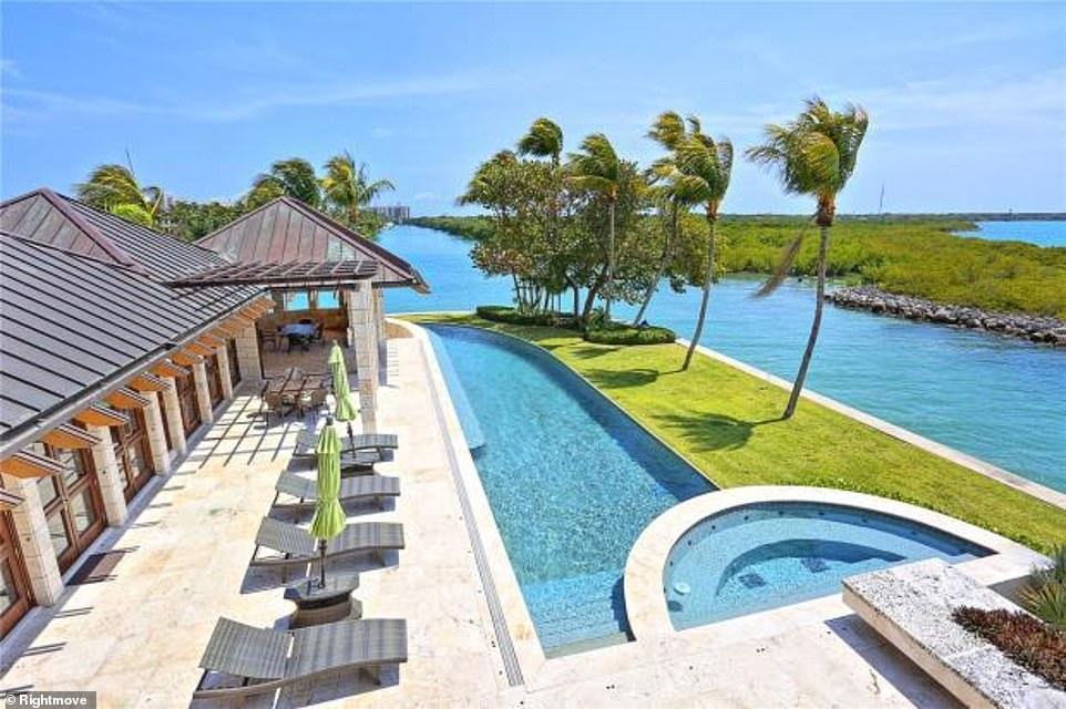 The luxury property in Miami boasts an outdoor swimming pool, and has a private dock that can accommodate a 100ft yacht