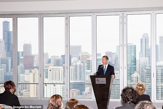 Arne Sorenson, CEO of Marriott International, welcomes guests with a view of the skyline at the grand opening of the Marriott Marquis Chicago on November 16, 2017 in Chicago