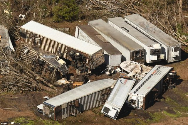 Several tractor-trailers were seen blown over by the EF-3 tornado which ripped through North Carolina on Monday night