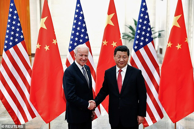 The British push for vaccination ceasefires could be a first key test of cooperation at the United Nations between China and the new administration of U.S. President Joe Biden. Pictured:Chinese President Xi Jinping shakes hands with then-U.S. Vice President Joe Biden (L) inside the Great Hall of the People in Beijing December 4, 2013