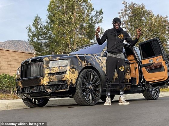 Wilder, pictured recently next to his custom Rolls Royce, has since come up with a long list of excuses for last year's defeat by Fury