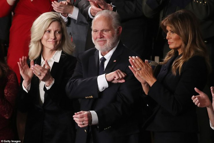 The day after revealing he had cancer, Limbaugh was invited by President Trump to attend his State of the Union where he was awarded the Presidential Medal of Freedom. He is pictured alongside his wife Kathryn and First Lady Melania Trump