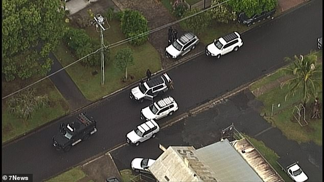 An armed man is reportedly holding a woman and a child as young as five hostage in a suburban home in Sunnybank on Brisbane's southside.Tactical police (pictured) have surrounded a home since Thursday afternoon