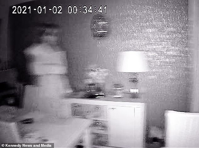 Un couple a été stupéfait après avoir attrapé une `` mariée fantôme '' blonde sur leurs caméras de vidéosurveillance activées par le mouvement à Aintree, Merseyside