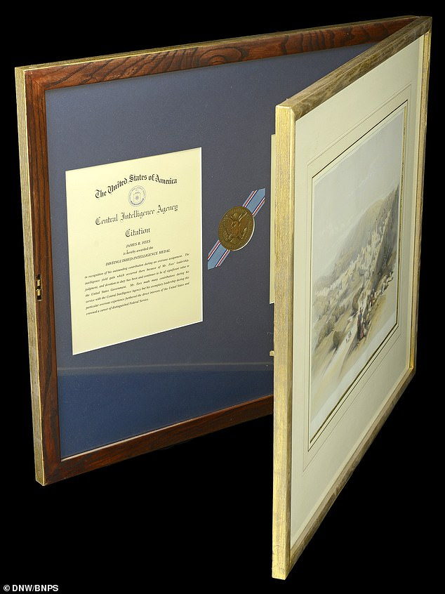 The secret medals of a CIA spy who managed to smuggle a Soviet MiG fighter jet into the US during the Cold War have been put up for action after they were hidden in a picture frame (pictured) for decades