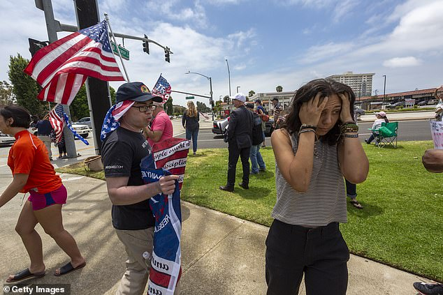 A woman turns away in frustration after arguing with a Trump supporter at a rally in California last June. A new study examines how political partisanship has seeped into every aspect of life