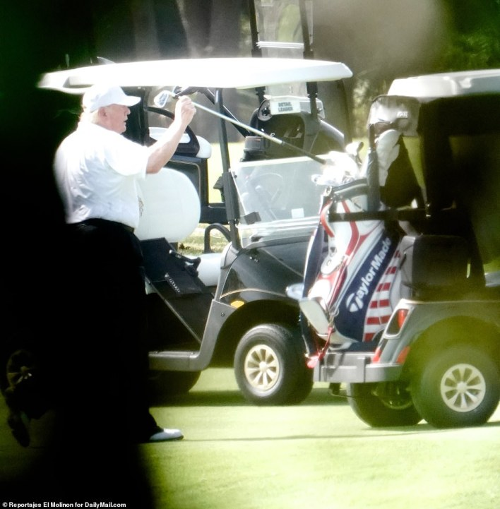 Trump, photographed near his golf cart Thursday, was blamed by House Democratic impeachment managers for inciting the January 6 insurrection because he continued to repeat the 'big lie' that the election was stolen from him