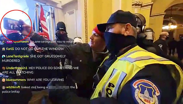 Among those suspended in a cop who was videoed posing for selfies (above) with rioters inside the legislature, Rep. Tim Ryan, a Democrat from Ohio, previously confirmed