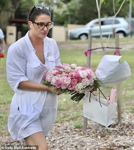 Mourners lit candles and laid down flowers in their daughter's and grandchildren's memory at a park in Brisbane's east, where a section has been named 'Hannah's Place'