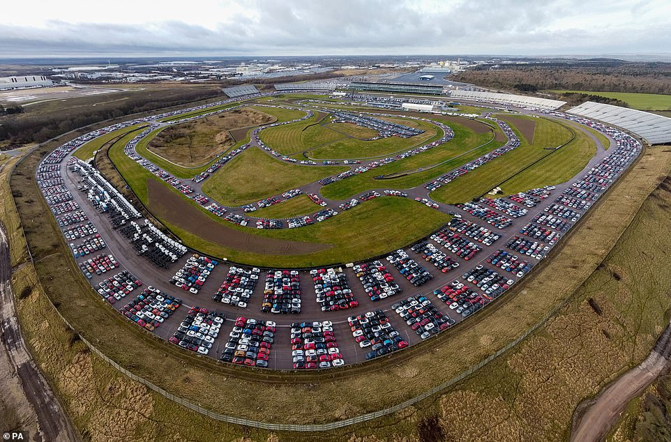 Not lining up on the grid: Thousands of used cars are being stored at the former Rockingham Motor Speedway site in Northamptonshire, showing the huge toll the pandemic is having on the UK's automotive sector