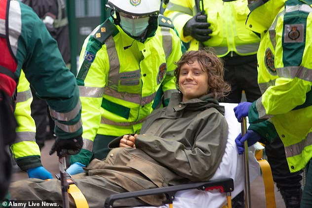 When Rory Hooper, 16, came out of the tunnel he was put on a stretcher and carried away to safety (pictured)