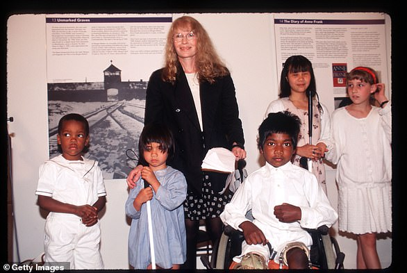 Mia with her children at the Anne Frank Center June 12, 1996 in New York City