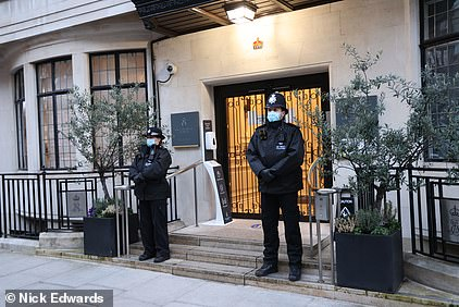 Police stand on the steps of King Edward VII Hospital today where Philip is being treated