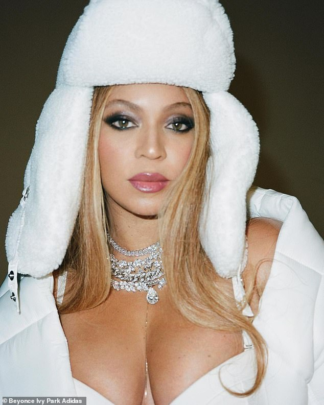 Promo push: She was all about using her famous face and cleavage when she wore a furry white hat and white coat;the third Adidas x Ivy Park collection drops Friday, Feb. 19